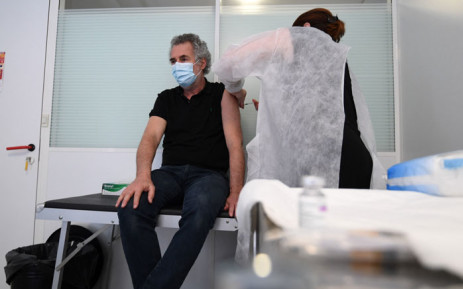 An occupational health practitioner vaccinates an employee with a dose of AstraZeneca COVID-19 Vaccine at a health centre for employees of the publicity and communication sectors on 25 February 2021 in Paris. Picture: AFP
