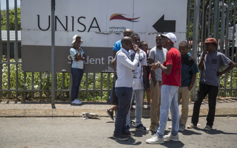 Students stand outside the Unisa Sunnyside campus in Pretoria after chaos broke out during registration on 15 January 2018. Picture: Ihsaan Haffejee/EWN