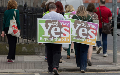 Activists from the 'Yes' campaign, urging people to vote 'yes' in the referendum to repeal the eighth amendment of the Irish constitution, canvas voters in Dublin on 24 May 2018. Picture: AFP