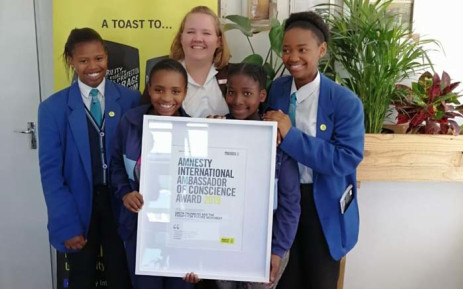 Ayakha Melithafa (Front-R) the African Climate Alliance winning the Ambassador of Conscience award from amnesty interactional. Picture: Supplied.