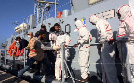 African migrants arrive at a naval base in Tripoli on November 25, 2017, after their rubber boat was rescued off the coast of Garabulli, 60 kilometres (40 miles) east of the Libyan capital. More than 30 migrants died and 200 others were rescued when their boats foundered off Libya's western coast, the Libyan navy said. Picture: AFP.