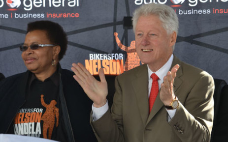 Former US President Bill Clinton with Graça Machel. Picture: Aletta Gardner/EWN