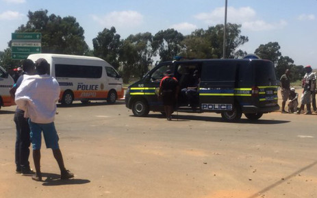 Police are monitoring a protest in Tshepisong where residents are demonstrating over electricity cuts on 23 December 2015. Picture: Masa Kekana/EWN.
