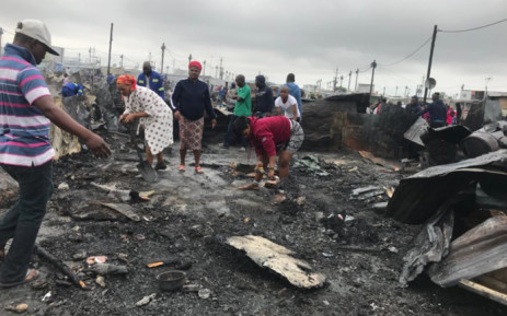 FILE: Dunoon residents clear the piece of land where their houses once stood following a fire on 13 March 2018. Picture: Shamiela Fisher/EWN.