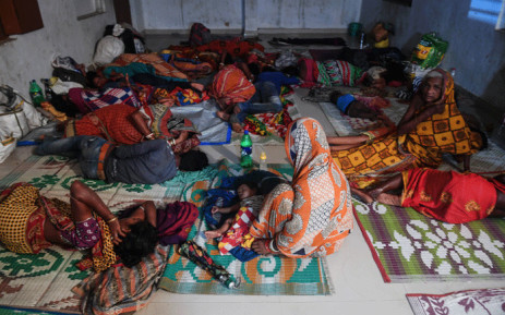 People evacuated for safety rest in a temporary cyclone relief shelter in Puri in the eastern Indian state of Odisha on 3 May 2019, as cyclone Fani approaches the Indian coastline. Picture: AFP