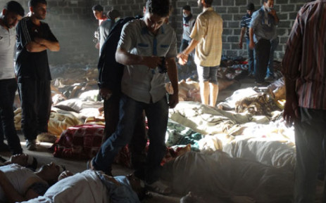An image by Shaam News Network shows people inspecting bodies of children and adults after they were allegedly killed in a toxic gas attack by pro-government forces. Picture: AFP