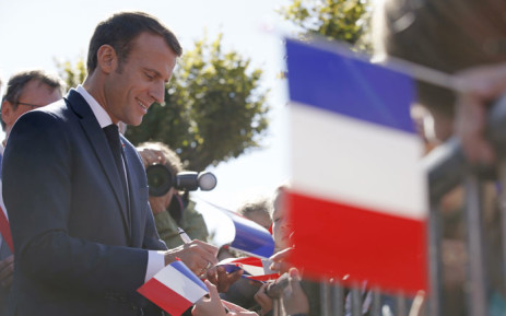French President Emmanuel Macron signs autographs after paying his respects at the grave of former French President Charles de Gaulle in Colombey-les-Deux-Eglises, France, on 4 October 2018 during a trip to mark the 60th anniversary of the French Constitution. Picture: AFP