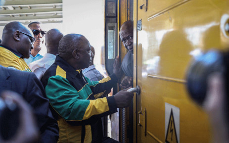 ANC president Cyril Ramaphosa interacts with commuters at Mabopane train station in Soshanguve on 18 March 2019 during the party's election campaign drive. Picture: Abigail Javier/EWN