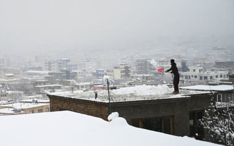 A man shovels snow from the roof of his house in Kabul on 2 January 2020. Picture: AFP