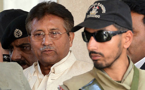Former Pakistani President Pervez Musharraf being escorted by authorities. Picture: AFP