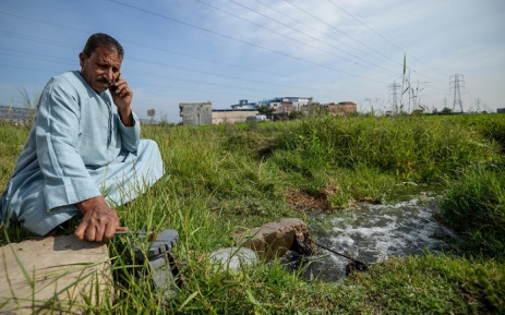A farmer closes the water valve of a pump in Kafr al-Dawar village in northern Egypt's Nile Delta, on 26 November 2018. Picture: AFP