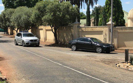 A vehicle is escorted from the president's official residence in Pretoria. Picture: Barry Bateman/EWN