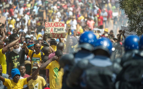 Police face off against protesting students on the south lawn of the Union Buildings in Pretoria during the Fees Must Fall march on 23 October 2015. Picture: AFP.