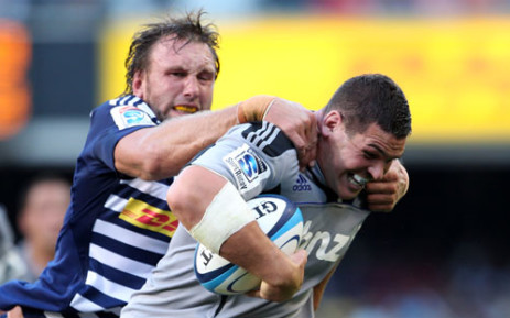 Andries Bekker (L) of the Stormers tackles Ben May of the Hurricanes during the Super 15 Rugby Match between the DHL Stormers and the Hurricanes at Newlands Stadium in Cape Town, on February 25, 2012.  Picture: AFP
