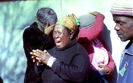 FILE: A group of relatives grieve 18 June 1992 after armed persons attacked residents overnight in this squatter camp south of Johannesburg. Picture: AFP.