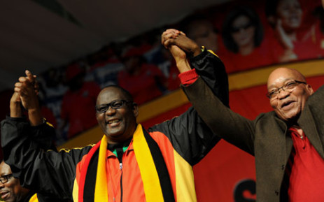Cosatu general secretary Zwelinzima Vavi and President Jacob Zuma at the trade union federation's 11th national congress at Gallagher Estate in Midrand on Monday, 17 September 2012. In the background is Cosatu's deputy general secretary Bheki Ntshalintshali. Picture: Werner Beukes/SAPA