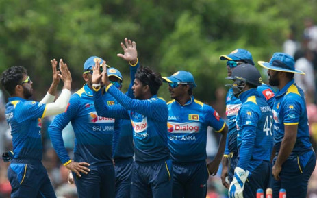 FILE: Sri Lanka's Akila Dananjaya celebrates with teammates after taking his fifth wicket during their match against South Africa. Picture: @OfficialCSA/Twitter