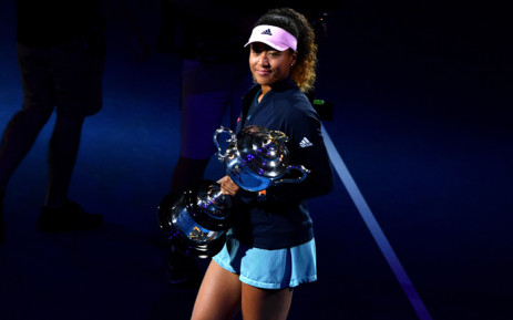 FILE: Japan's Naomi Osaka celebrates with the championship trophy during the presentation ceremony after her victory against Czech Republic's Petra Kvitova in the women's singles final on day 13 of the Australian Open. Picture: AFP.