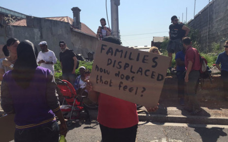 Dozens of people protested outside the Old Biscuit Mill against the eviction of 28 families from Woodstock. Picture: Monique Mortlock/EWN.