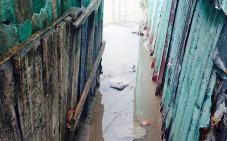 Flooding in between shacks in Khayelitsha on 6 July. Picture: Shamiela Fisher/EWN.