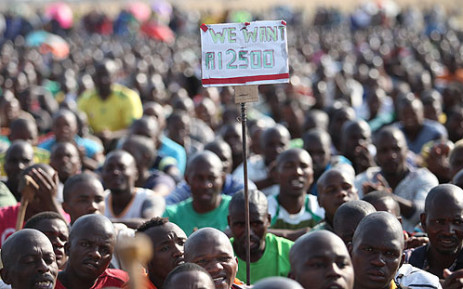 Striking workers at Lonmin's Marikana mine continue to demand R12,500 in wages. Picture: Taurai Maduna/Eyewitness News.