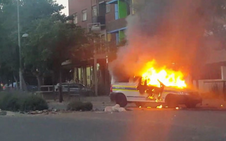 A Police van is on fire in Braamfontein. Picture: Twitter screengrab.