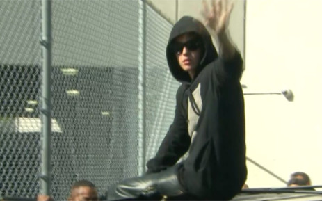 Bieber's bodyguards has been arrested and charged with stealing a photographer's $10,000 camera. Picture: CNN.