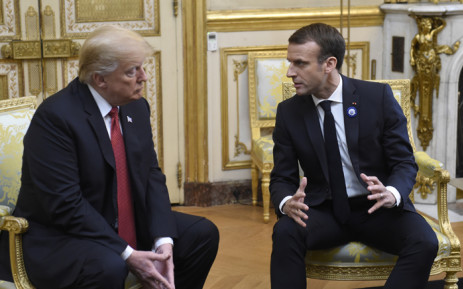 US President Donald Trump (L) speaks with French president Emmanuel Macron prior to their meeting at the Elysee Palace in Paris, on November 10, 2018, on the sidelines of commemorations marking the 100th anniversary of the 11 November 1918 armistice, ending World War I. Picture: AFP.