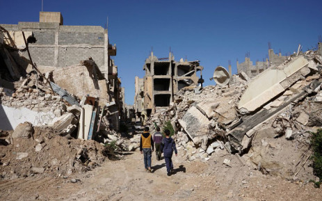 Libyan children walk through the ruins of a building. Picture: @UN/Twitter