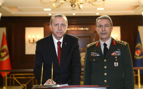 Turkish President Recep Tayyip Erdogan (left) delivering a speech as Chief of the General Staff of the Turkish Armed Forces, as Hulusi Akar stands next to him during his condolence visit at the General Staff headquarters in Ankara. Picture: AFP.
