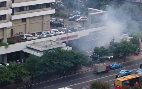 Multiple explosions were heard in the centre of the Indonesian capital Jakarta this morning. Picture: Edward Rees ‏@ReesEdward