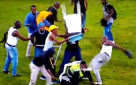 FILE: A screengrab of a security guard being attacked by Kaizer Chiefs fans following their defeat to Free State Stars in a Nedbank Cup match at the Moses Mabhida Stadium on 21 April 2018.