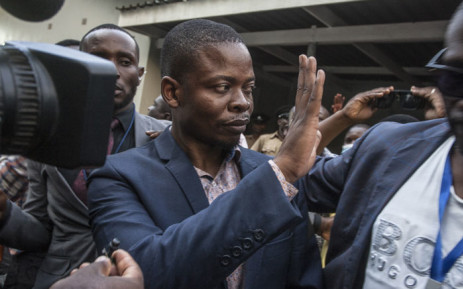 Malawian preacher Shepherd Bushiri waves at supporters as he leaves the Lilongwe Magistrates Court on 19 November 2020, after skipping bail in South Africa and being arrested in Malawi. Picture: AFP
