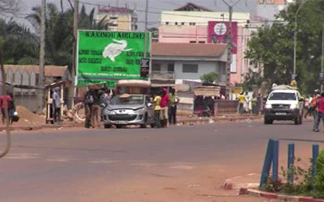 """A video grab shows overloaded cars and suspected looters carrying goods in a street in Bangui on March 24, 2013. Looters and armed gangs roamed the streets of the Central African Republic capital after rebels seized control of the city. Picture: AFP"""""""