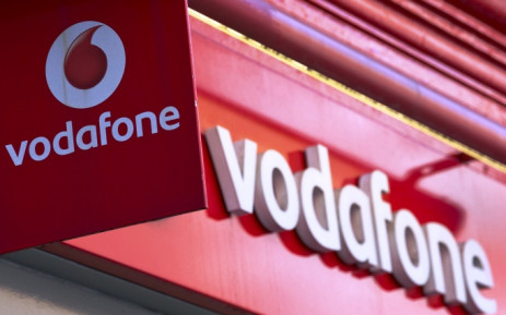 FILE: Vodafone signage seen outside a store in central London on 4 September, 2013. Picture: AFP