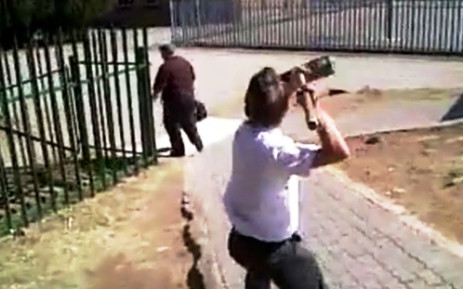 Screenshot from a viral cell phone video shows a grade 8 Glenvista High School student attacking his teacher with a broom on 18 September 2013. It was sent to EWN by a concerned parent and was filmed by another student.