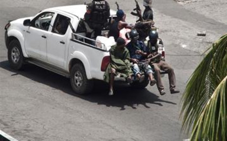 Pro-Gbagbo militiamen patrol in the empty streets of Abidjan on March 31 2011.  Picture: AFP