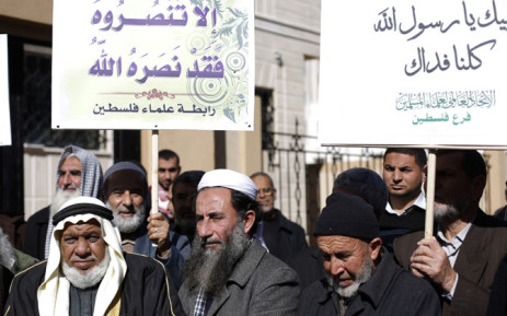 Palestinian men, holding placards bearing slogans praising Islam's Prophet Mohammed, take part in a demonstration in protest against a recent cartoon of the prophet that was published by the French satirical magazine Charlie Hebdo. Picture: AFP.