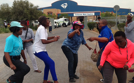 FILE: Women sing and dance outside the Tshwane Mail Centre in Pretoria on 15 October 2014. Picture: Vumani Mkhize/EWN.