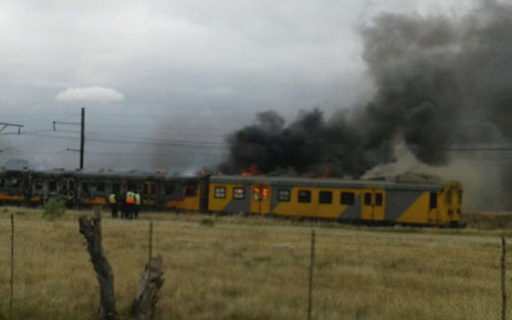 Cape Town firefighters on the scene of a burning train on Century City line. Picture: City of Cape Town.