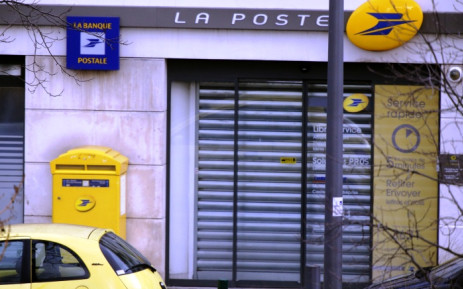 Picture taken of the post office where an armed man is holed up with two hostages, on 16 January, 2015 in Colombes, outside Paris. Picture: AFP.