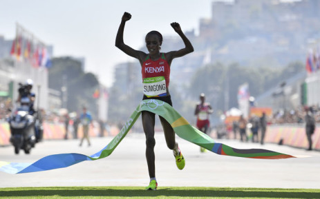 FILE: Kenya's Jemima Jelagat Sumgong raises her arms in victory as she crosses the finish line of the Women's Marathon during the athletics event at the Rio 2016 Olympic Games at Sambodromo in Rio de Janeiro on 14 August, 2016. Picture: AFP