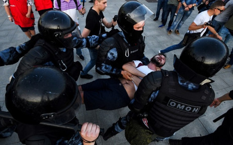 Riot police officers detain a protester during an unauthorised rally demanding independent and opposition candidates be allowed to run for office in local election in September, at Moscow's Trubnaya Square on 27 July 2019. Picture: AFP