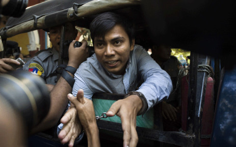 FILE: Reuters journalist Kyaw Soe Oo (C) talks to the media as he leaves after a court appearance in Yangon on 10 January 2018. Picture: AFP.