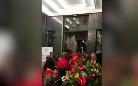 A video screengrab shows EFF MP Marshall Dlamini assault an unknown man after the 2019 State of the Nation Address. Picture: EWN.