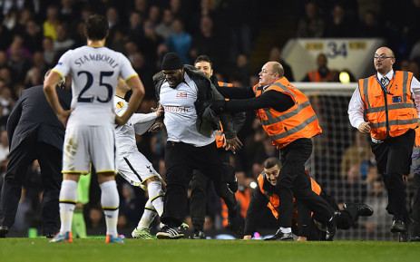 A pitch invader wearing a marketing t-shirt belonging to headphone manufacturer Bass Buds, invades the pitch during a Europa League match on 28 November 2014. Picture: AFP