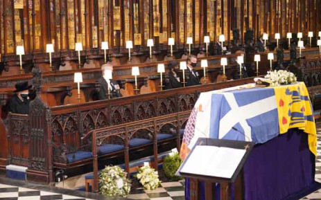 Queen Elizabeth II looks at the coffin of Britain's Prince Philip, Duke of Edinburgh, during his funeral service at St George's Chapel in Windsor Castle in Windsor, west of London, on 17 April 2021. Picture: Jonathan Brady/POOL/AFP