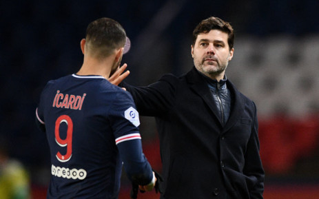 Paris Saint-Germain's Argentinian forward Mauro Icardi (L) and Paris Saint-Germain's Argentine head coach Mauricio Pochettino celebrate after winning the French L1 football match between Paris Saint-Germain and Nimes Olympique at the Parc des Princes stadium in Paris o3 n February 2021. Picture: FRANCK FIFE/AFP