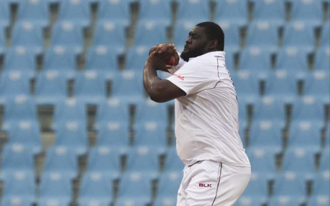 West Indies' Rahkeem Cornwall delivers a ball during the third day of the only cricket Test match between Afghanistan and West Indies at the Ekana Cricket Stadium in Lucknow on 29 November 2019. Picture: AFP.