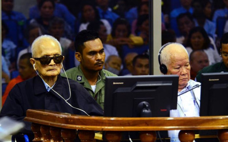 """This handout photo taken and released by the Extraordinary Chambers in the Courts of Cambodia on 23 November 2016 shows former Khmer Rouge leader """"Brother Number Two"""" Nuon Chea (L) and former Khmer Rouge head of state Khieu Samphan (R) sitting in the courtroom in Phnom Penh. Picture: AFP"""